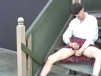 Furious crossdresser stroking on the stairs