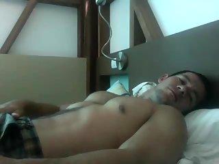 Sexy guy masturbates on his bed