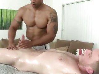 Black masseur sucking white dick during hot massage