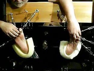 Bondaged Guy Gets His Feet Tickled